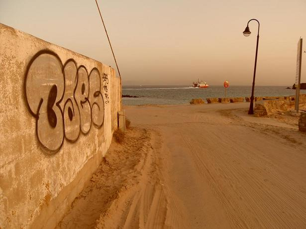 Tarifa, Spain sunset and graffiti, looking towards Africa