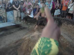 Digging up the pig at Old Lahaina Luau